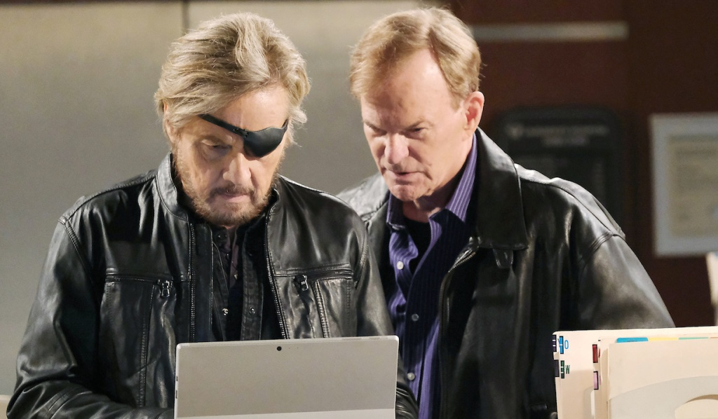 Steve and Roman look through hospital files on Days of Our Lives