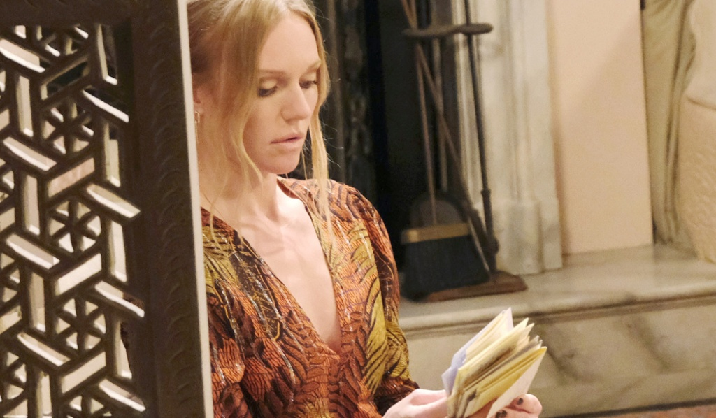 Abigail looks at a stack of letters on Days of Our Lives