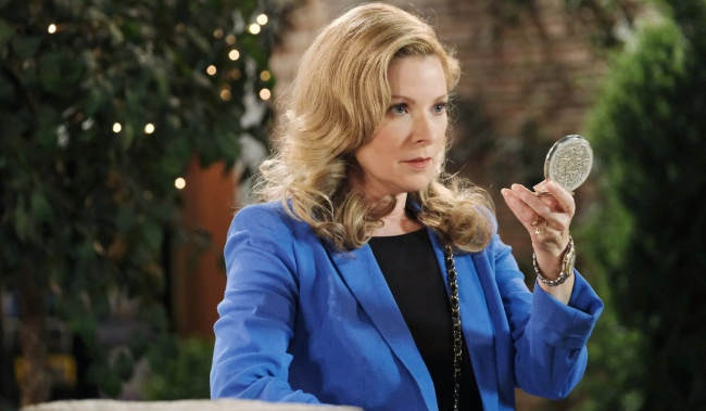 Jennifer looks seriously into her compact on Days of Our Lives