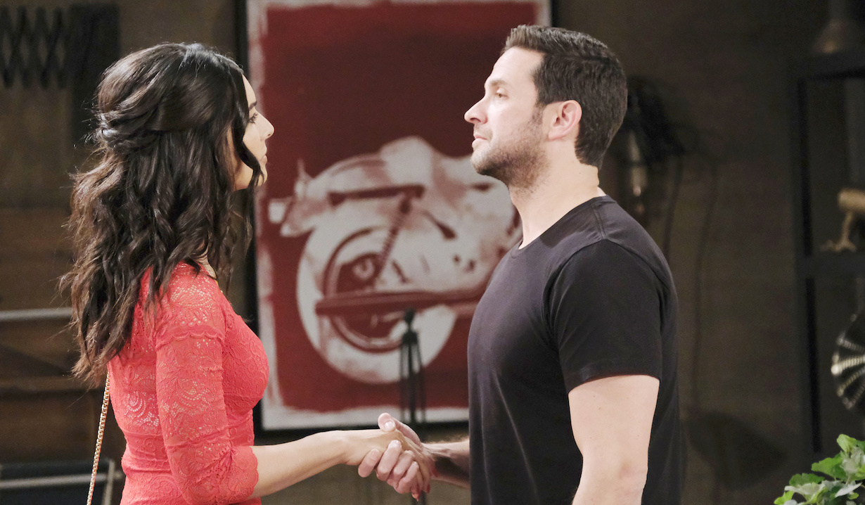 Gabi and Jake shake hands in his garage on Days of Our Lives