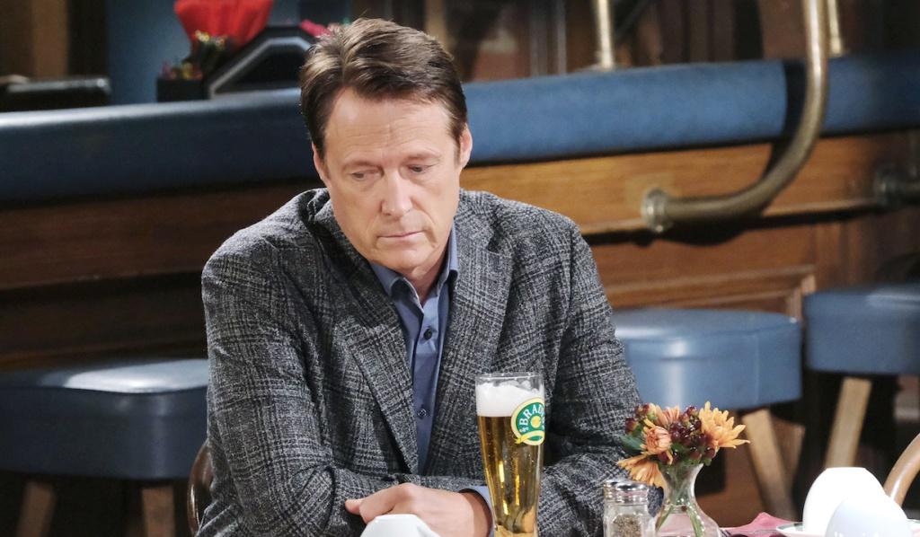 Jack looks sad drinking a beer at Brady's Pub on Days of Our Lives