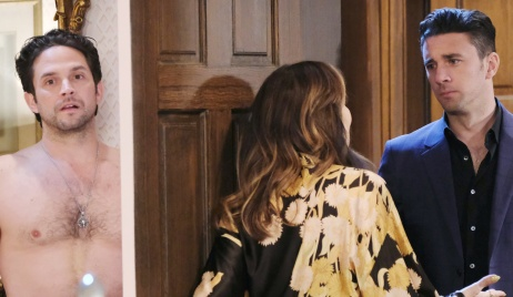Jake hides in Kate's bedroom as she opens the door to Chad on Days of Our Lives