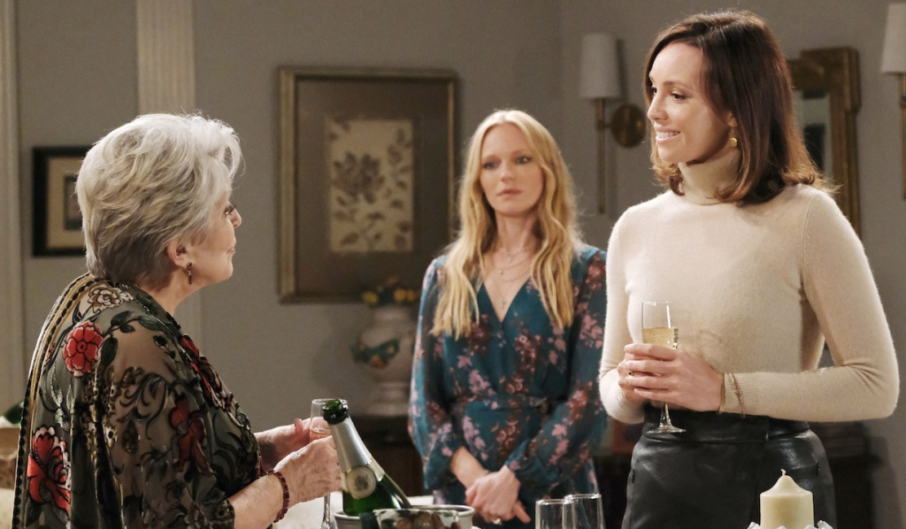 Abigail watches as Julie and Gwen have a glass of champagne on Days of Our Lives