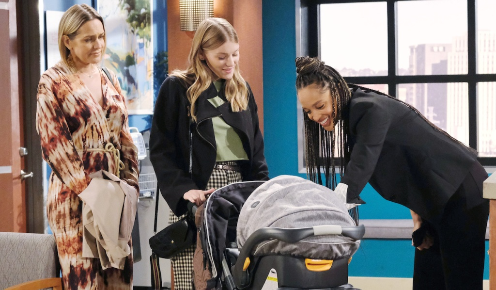 Lani smiles at Henry with Nicole and Allie at the hospital on Days of Our Lives