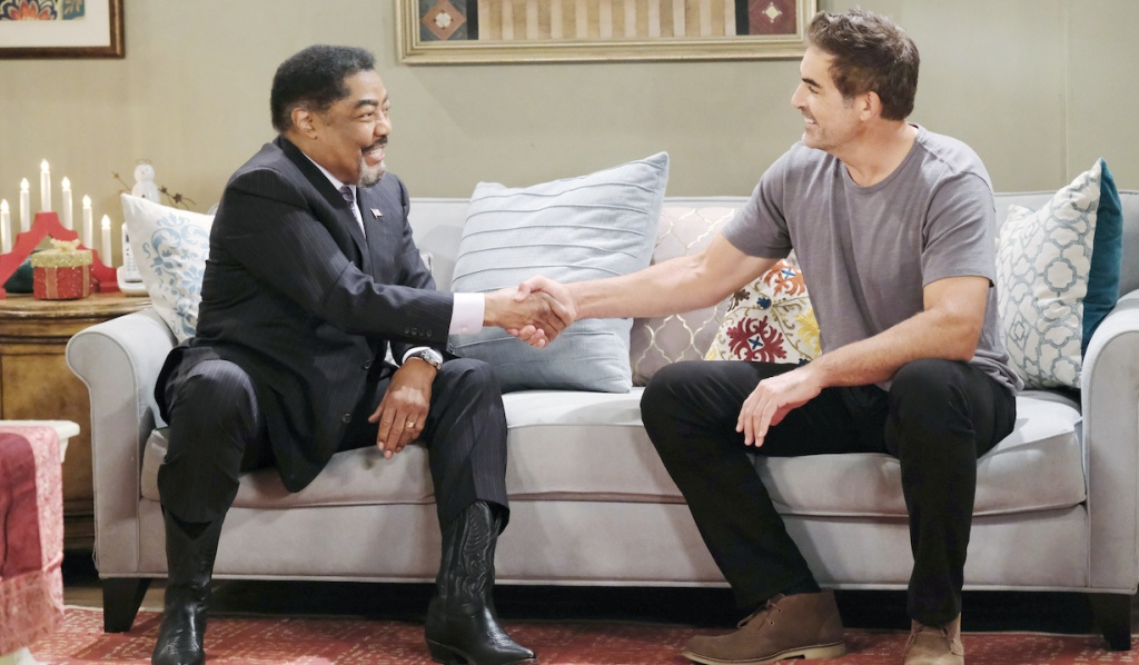 Abe in cowboy boots shakes hands with Rafe on Days of Our Lives