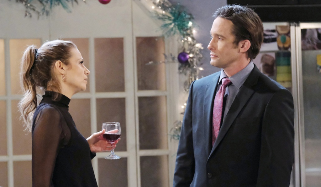 Ava drinks wine while talking to Philip on Days of Our Lives