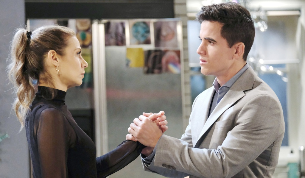 Charlie clasps Ava's hand on Days of Our Lives