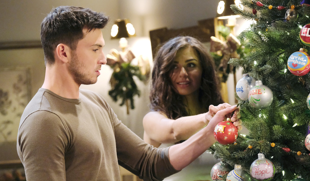 Ciara helps Ben put his ornament on the tree days