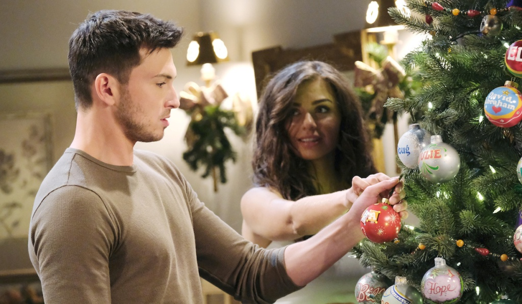 Ciara helps Ben put his ornament on the tree on Days of Our Lives