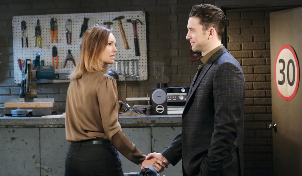 Gwen and Chad hold hands in Jake's garage on Days of Our Lives