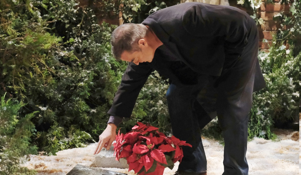 Justin puts flowers on Bonnie's grave on Days of Our Lives