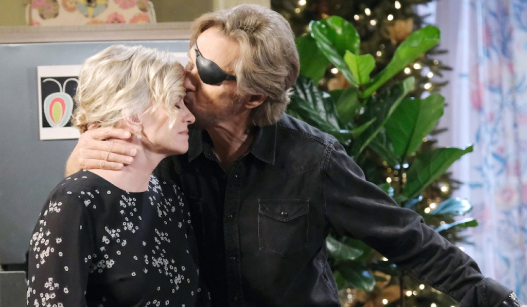 Steve kisses Kayla on the forehead on Days of Our Lives