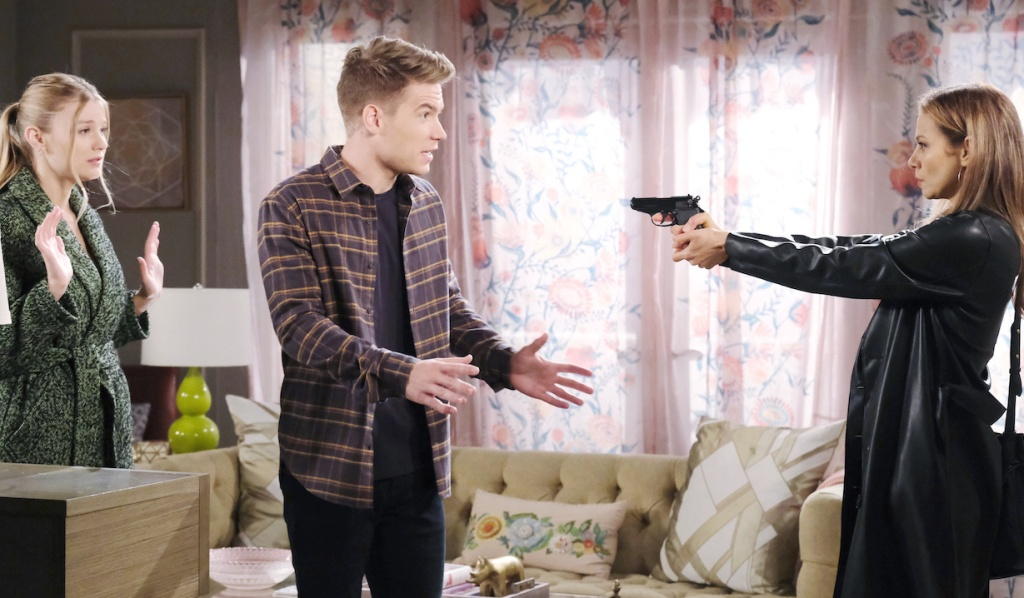 Tripp protects Allie from Ava's gun on Days of Our Lives