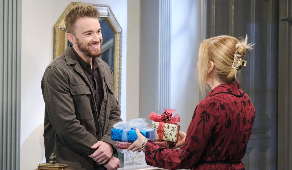 Will and Jennifer with Christmas presents on Days of Our Lives