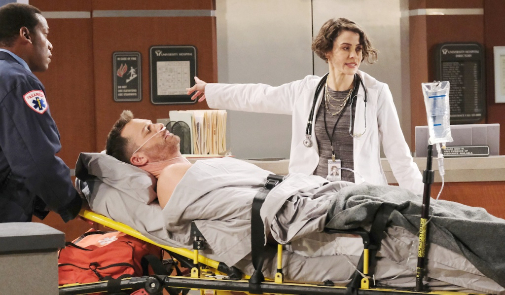Brady is wheeled into the hospitl on a stretcher on Days of Our Lives