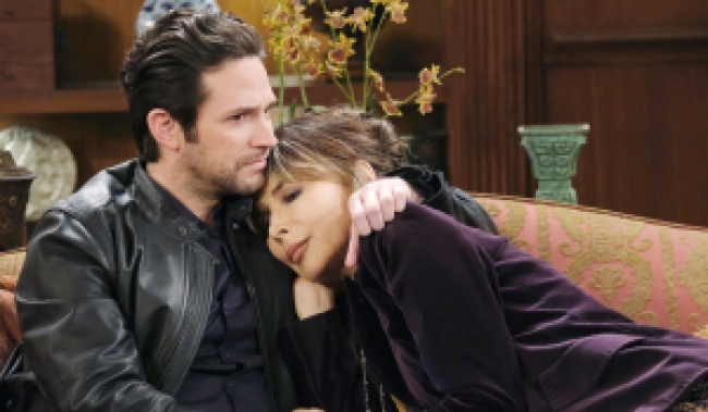 Jake holds Kate on the DiMera couch on Days of Our Lives