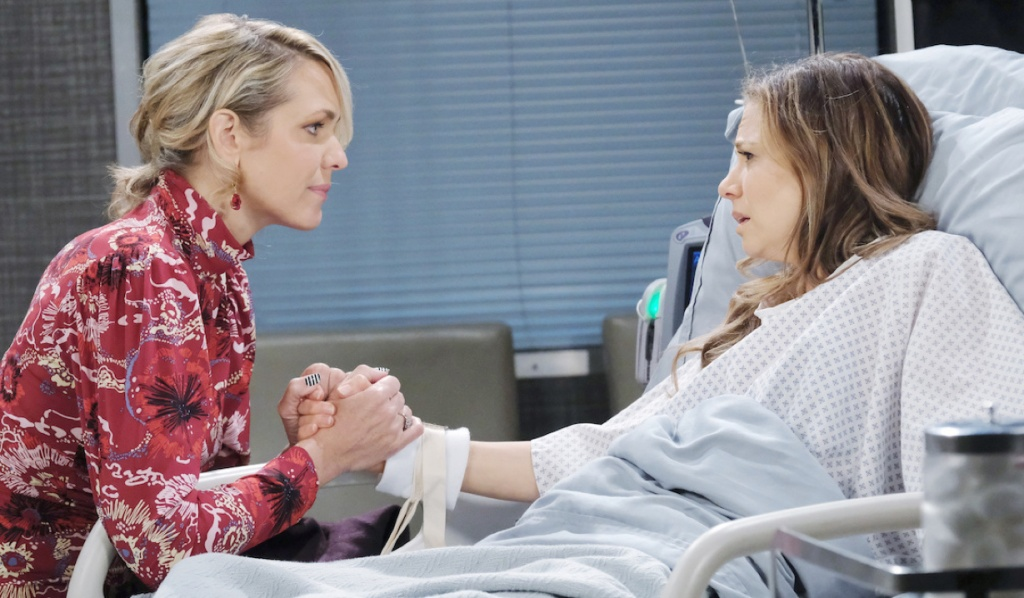 Nicole holds an emotional Ava's hand at the hospital on Days of Our Lives