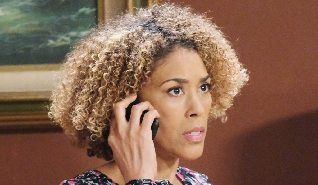 Dr. Raynor makes a call from her motel on Days of Our Lives