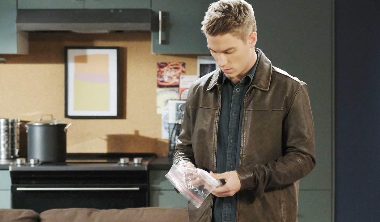 Tripp searches Charlie's apartment on Days of Our Lives