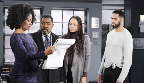 Val looks at a sketch of the kidnapper on Days of Our Lives