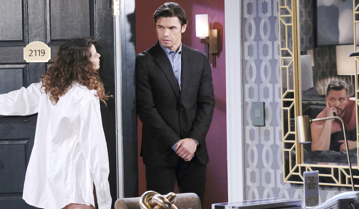 Sarah, in Brady's shirt, opens hotel door to Xander, as Brady lies in bed on Days of Our Lives