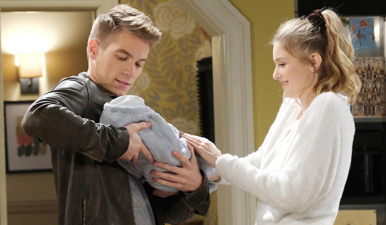 Allie helps Tripp hold Henry