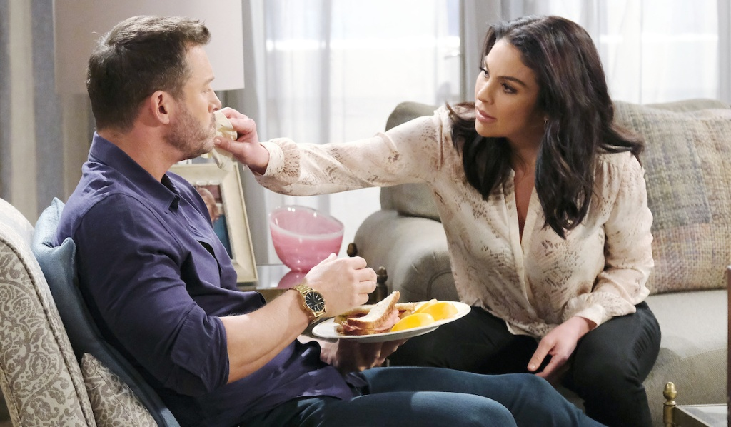 Chloe tends to Brady while he eats on Days of Our Lives