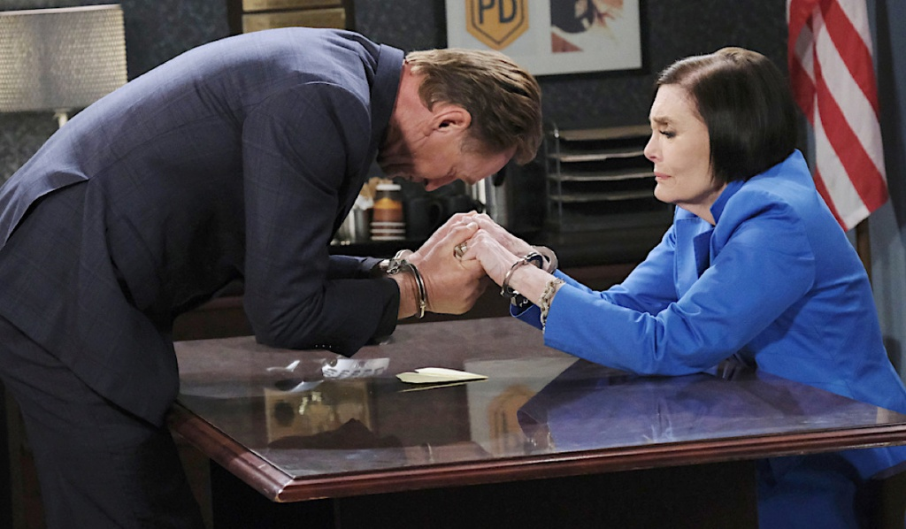 Ivan and Vivian in handcuffs at the Salem PD on Days of Our Lives