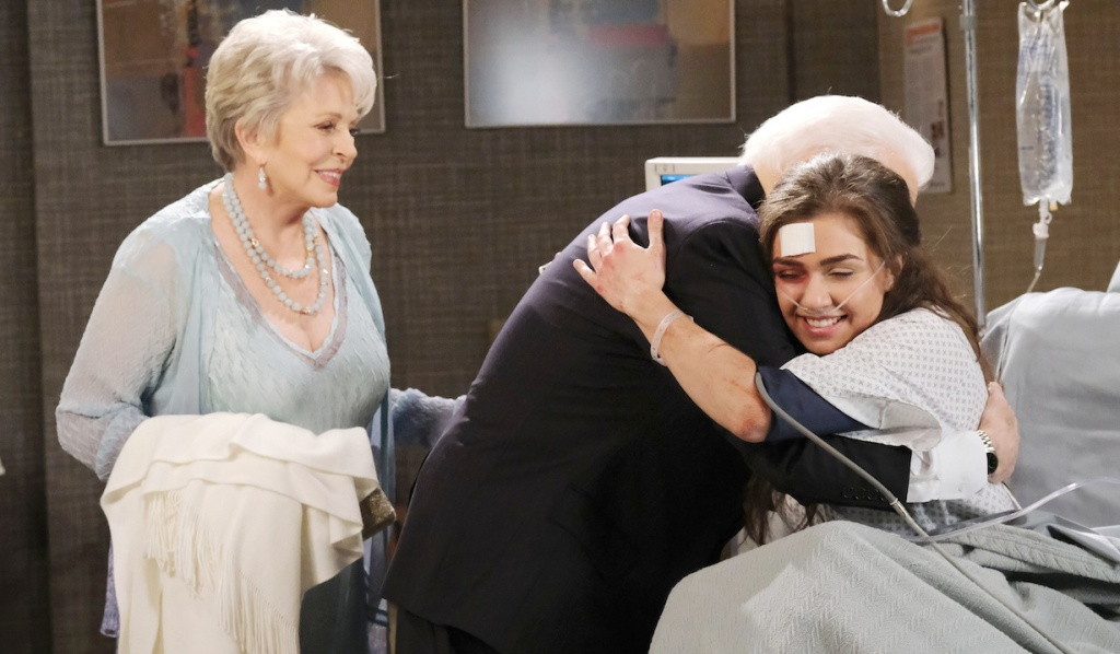 Julie watches as Doug hugs Ciara in the hospital on Days of Our Lives