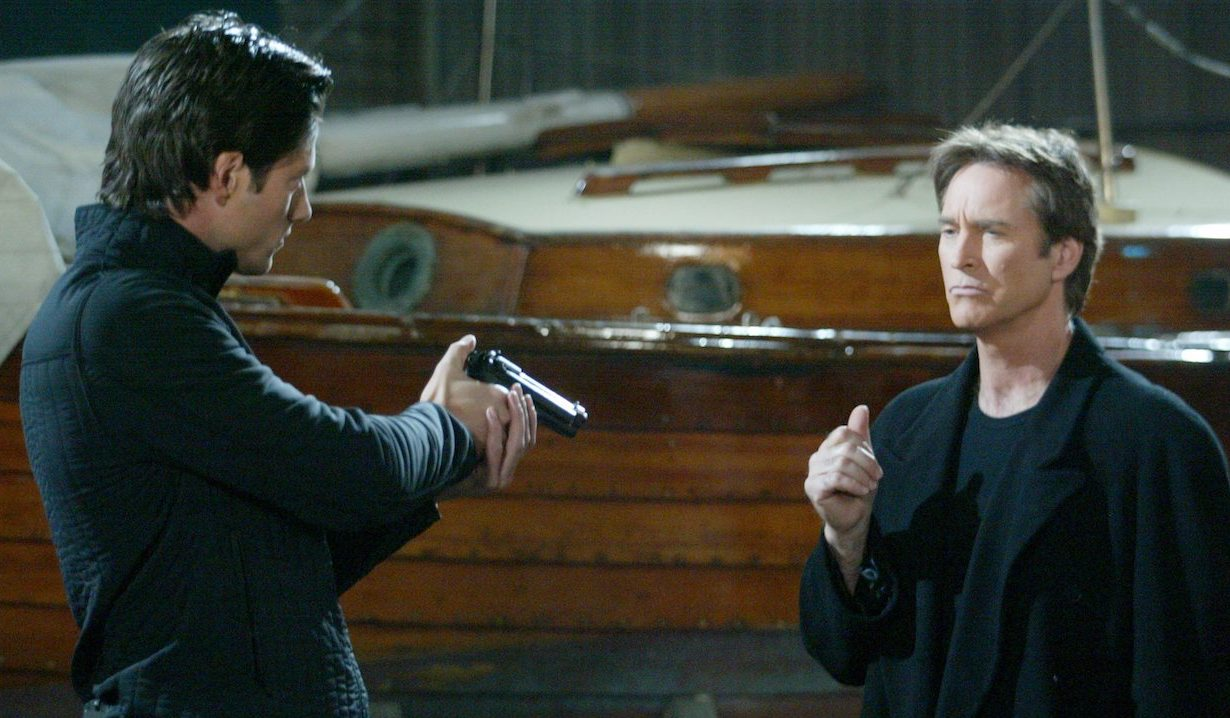 E.J. holds a gun on John at the docks on Days of Our Lives