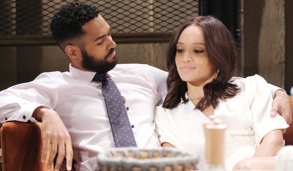 Eli and Lani cuddle on the couch on Days of Our Lives