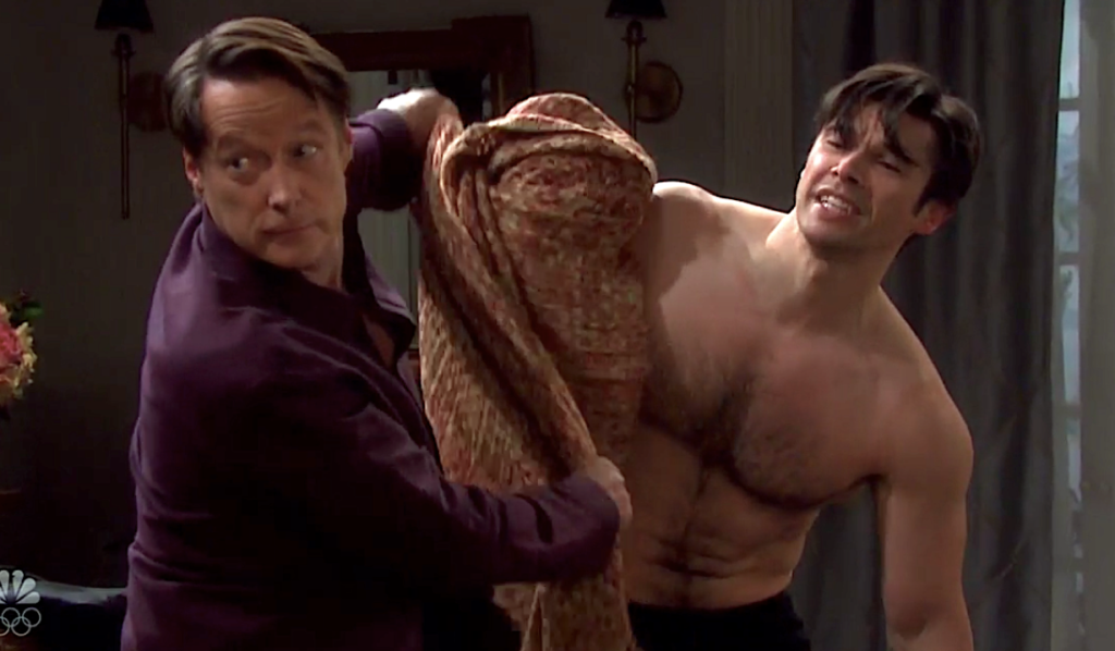 Jack tries to cover a naked Xander with a blanket on Days of Our Lives