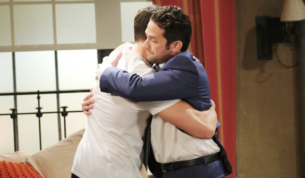 Ben and Jake hug in Ben's studio on Days of Our Lives
