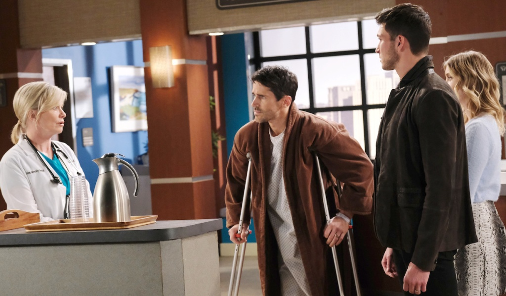 Shawn on crutches at the hospital with Kayla, Ben and Claire