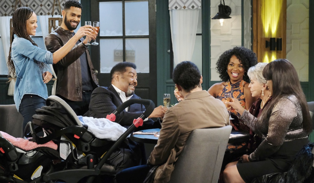 Eli and Lani toast with thier family at Julie's Place on Days of Our Lives