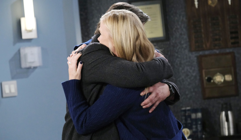 Lucas and Sami hug at the police station on Days of Our Lives