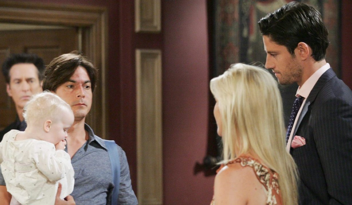 Lucas holds Allie while facing Sami and E.J. on Days of Our Lives