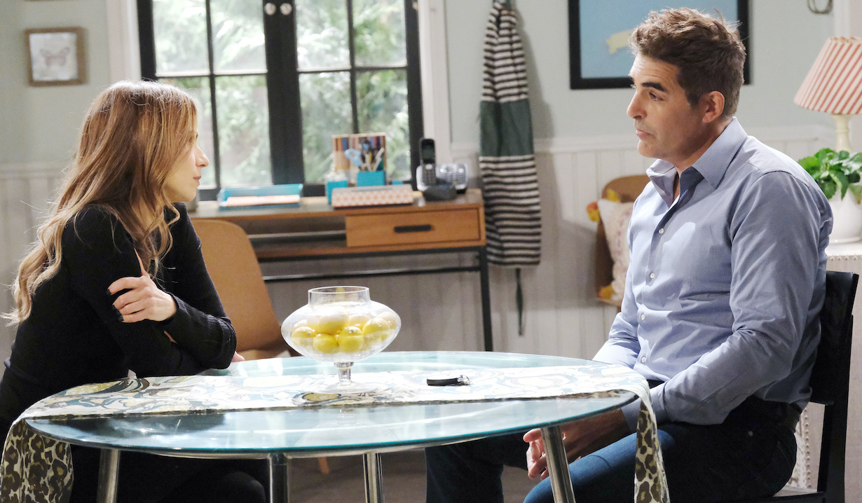 Ava and Rafe talk at kitchen table on Days of Our Lives