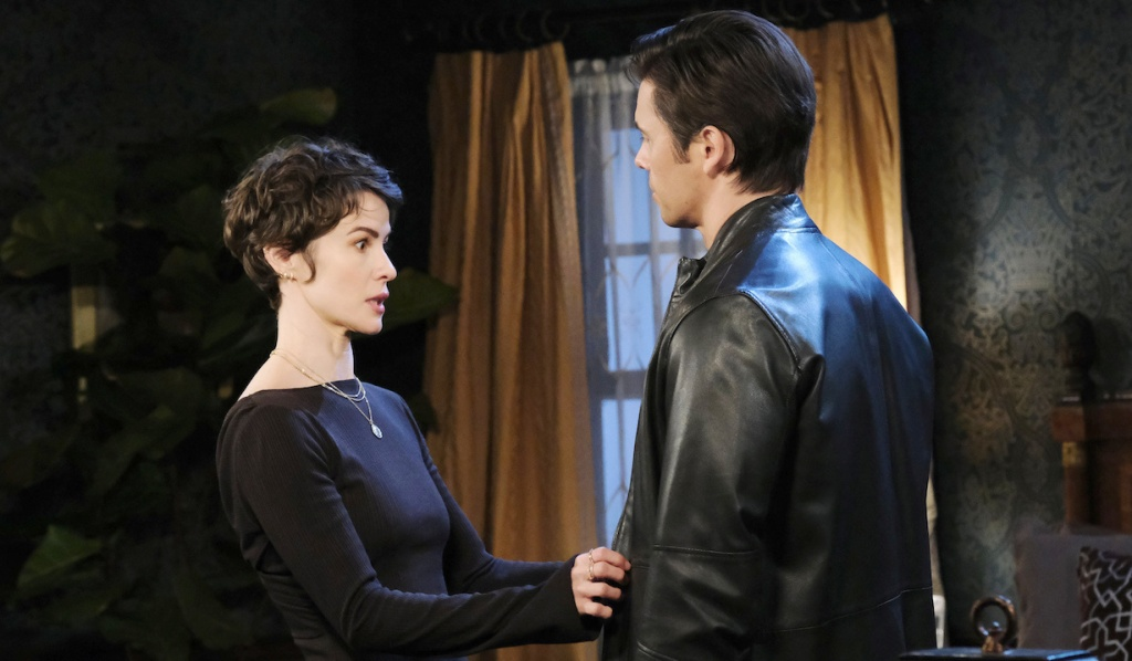 Sarah wide-eyed talking to Xander on Days of Our Lives