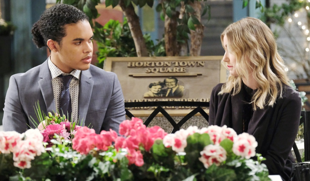 Theo and Claire sit on a bench in Horton Square on Days of Our Lives