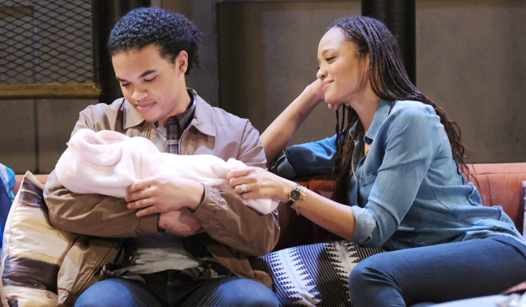 Lani smiles as Theo holds one of the babies on Days of Our Lives