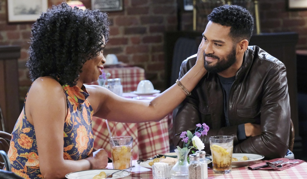 Val touches a smiling Eli's face at Brady's Pub on Days of Our Lives