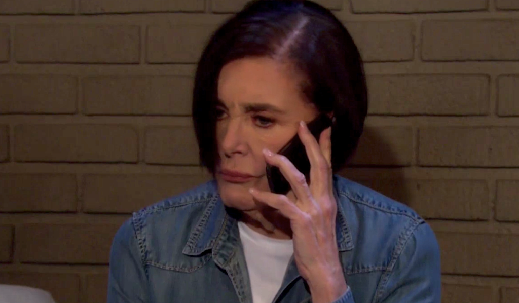 Vivian talks on a cell phone from her cell on Days of Our Lives