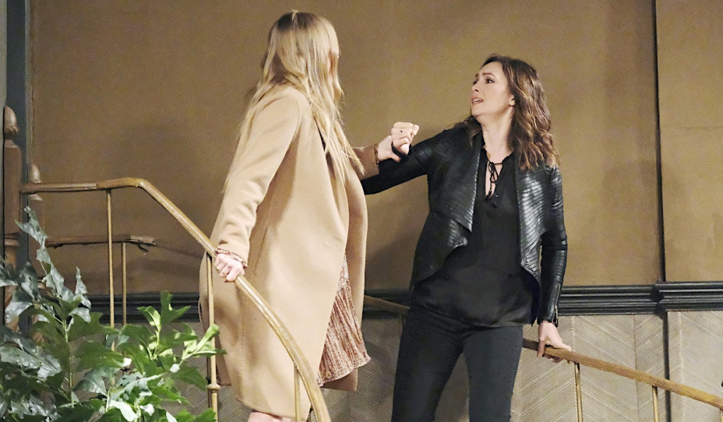 Abigail grabs Gwen at the top of the stairs on Days of Our Lives