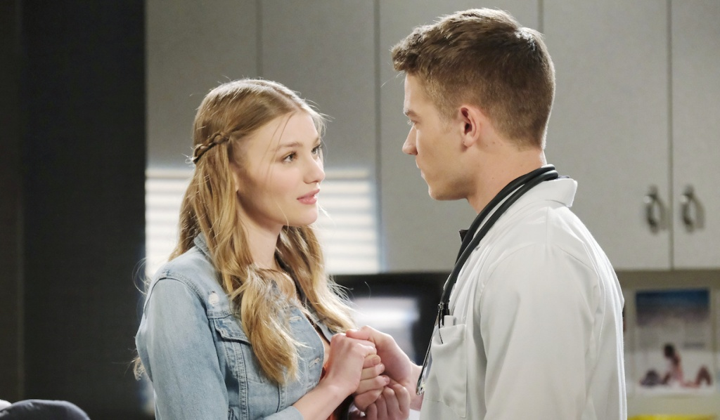 Allie clasps Tripp's hand on Days of Our Lives
