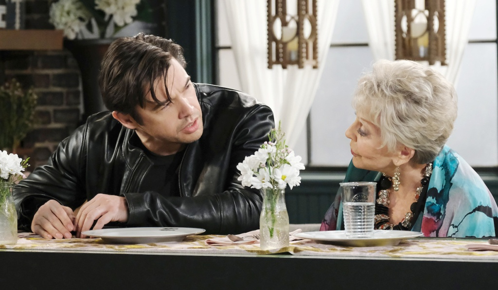 A drunk Xander talks to Julie at Julie's Place on Days of Our Lives