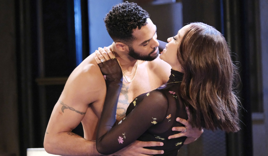 A shirtless Eli sweeps Lani into his arms on Days of Our Lives