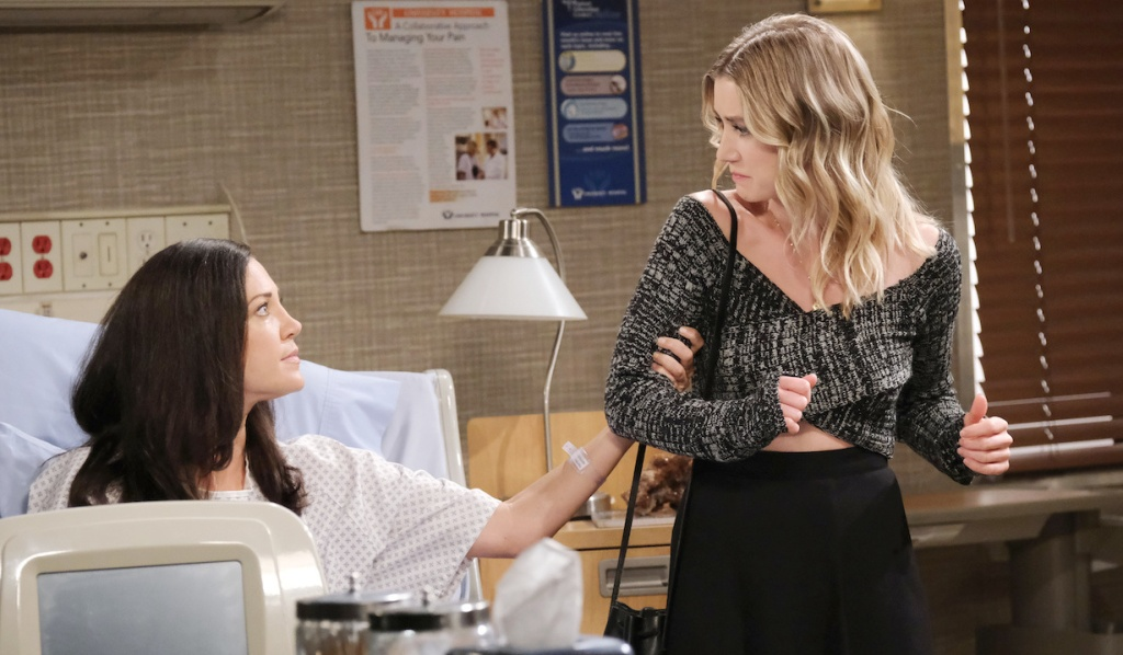 Jan grabs Claire's arm at the hospital on Days of Our Lives
