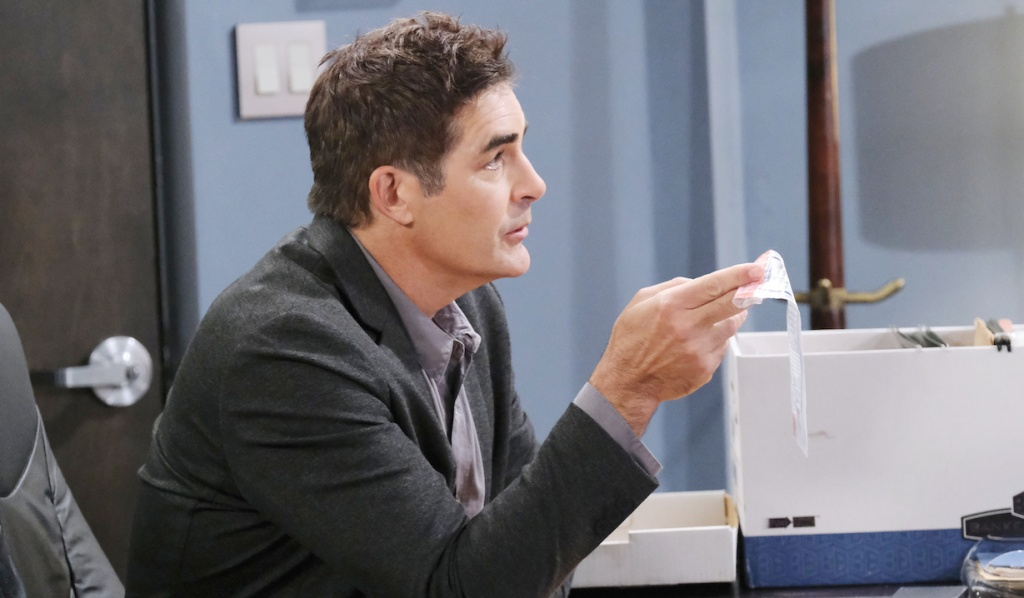 Rafe holds an evidence bag on Days of Our Lives