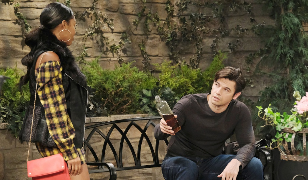 Xander offers Chanel a bottle of booze in the park on Days of Our Lives
